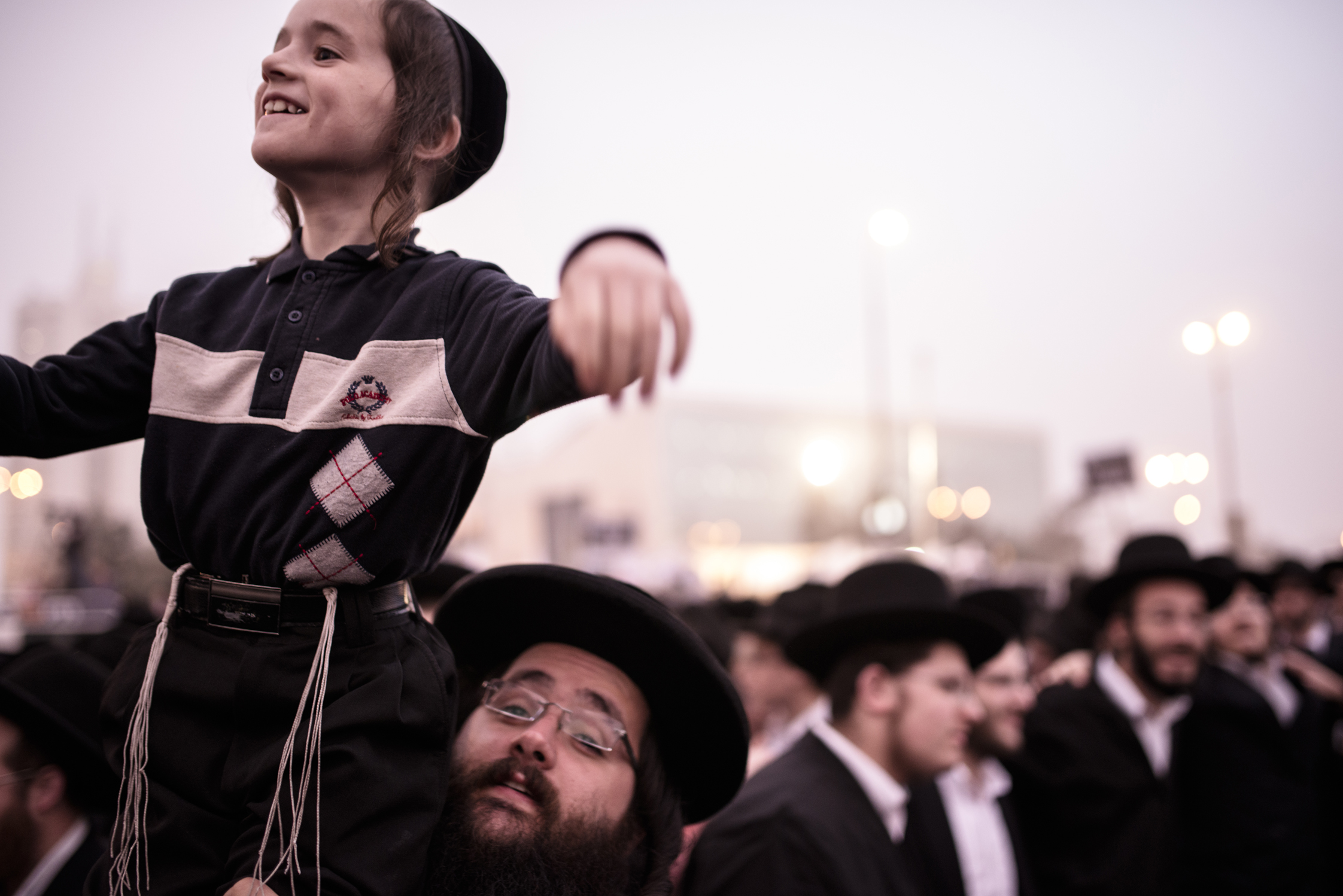 A father lifts his son as hundreds of thousands of Ultra Orthodox Jews demonstrate in Jerusalem against any plans to make them undergo military service. The protests were sparked by cuts in government funding to Jewish theological seminaries, or yeshivas, and a planned crackdown on young ultra-Orthodox men seeking to avoid Israel's compulsory military draft. The picture was taken in Jerusalem, Israel, 2nd Mar 2014.