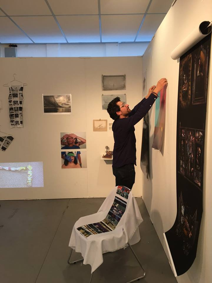 Felipe Castelblanco from Mote 078 Gallery, USA, caught in the action of hanging up an art work. Photo: Maria Högbacke.