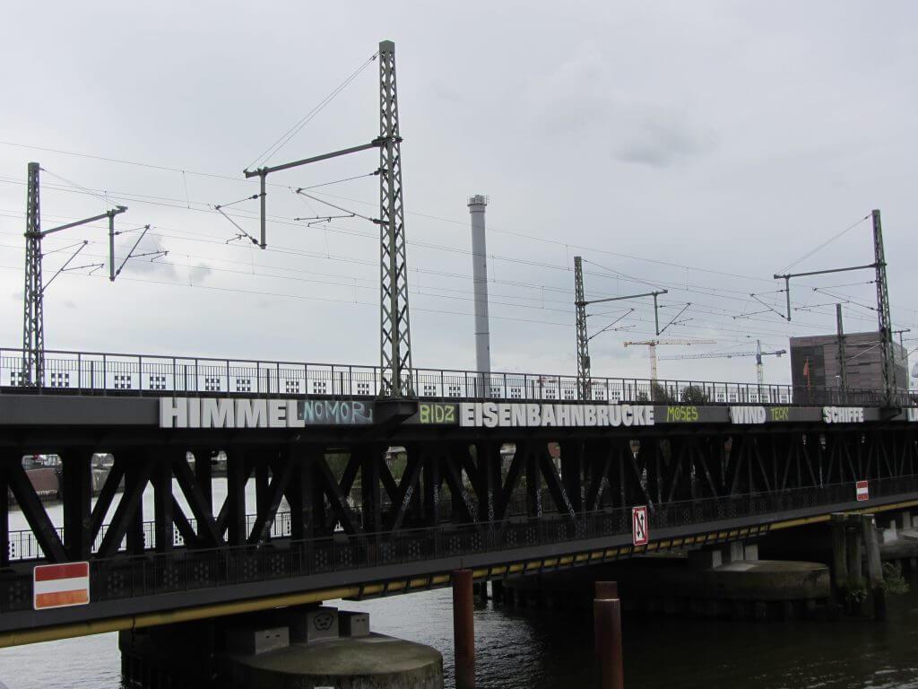 Rémy Zaugg: Kanäle, Eisenbahnbrücke, Lagerhäuser, Schiff, Wolken, Himmel, Wind, Hafenkräne, 1992