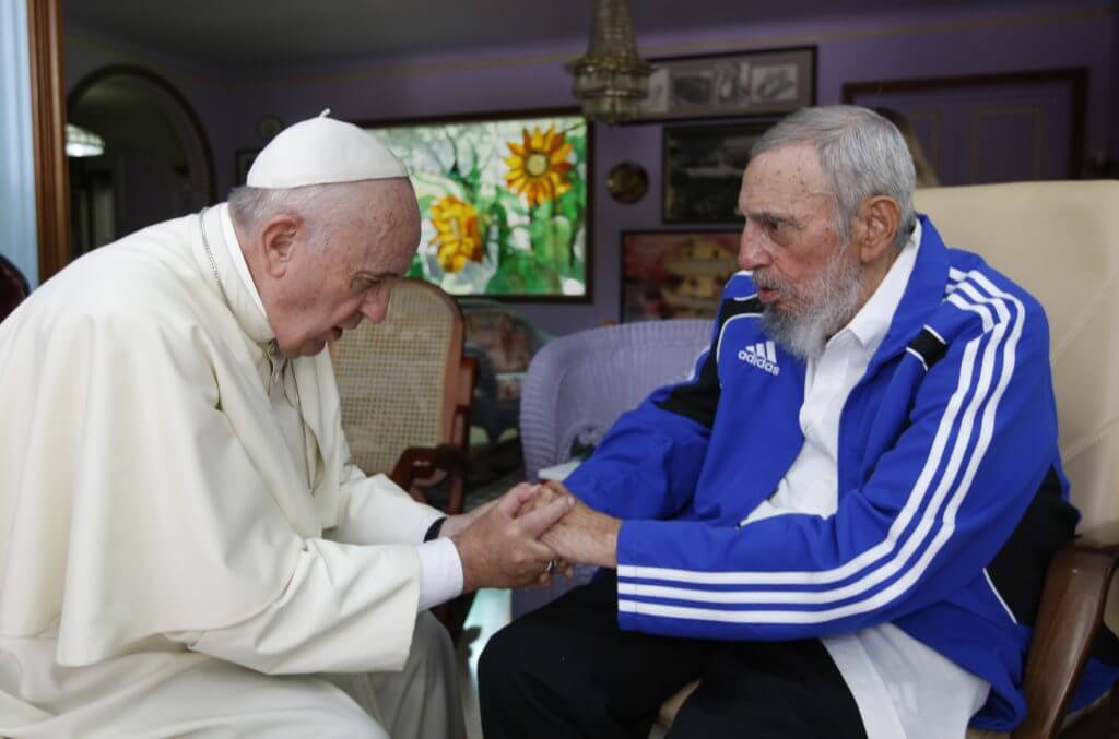 In this Sunday, Sept. 20, 2015 photo, Pope Francis holds hands with Fidel Castro in Havana, Cuba. The Vatican described the 40-minute meeting at Castro's residence as informal and familial, with an exchange of books. (AP Photo/Alex Castro) |