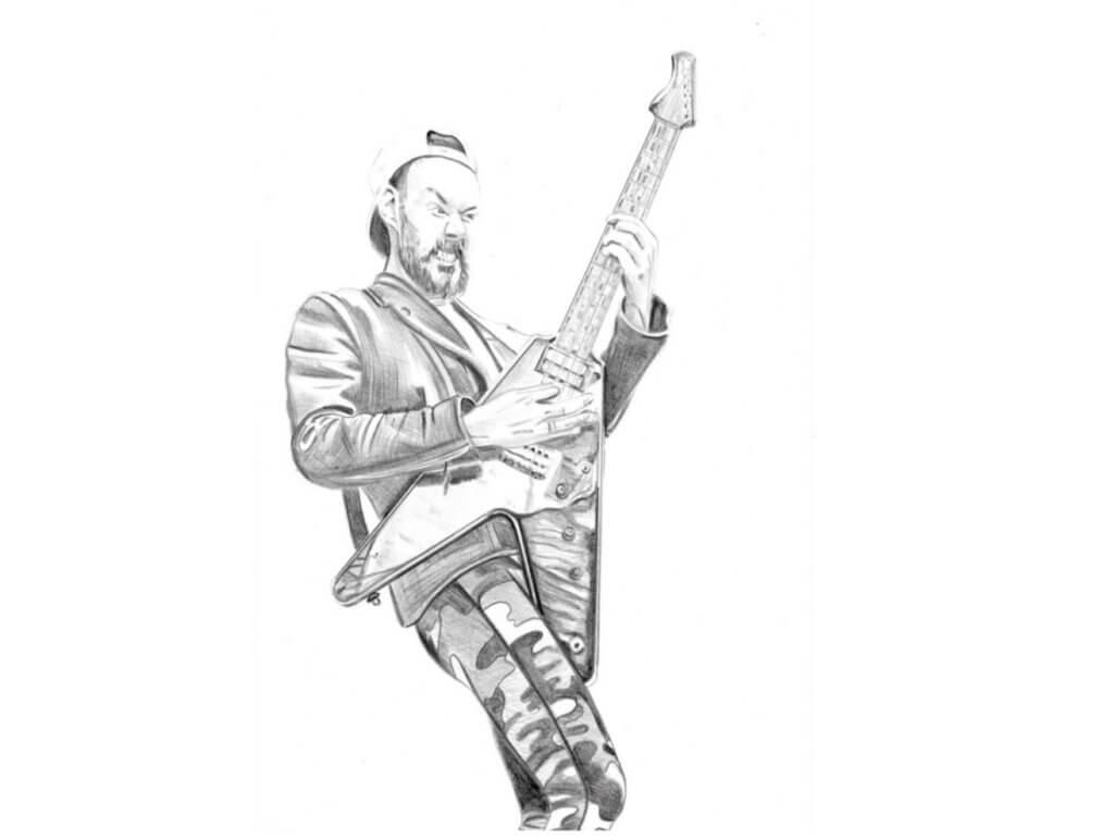 Mann, der verbissen auf Gitarre spielt.