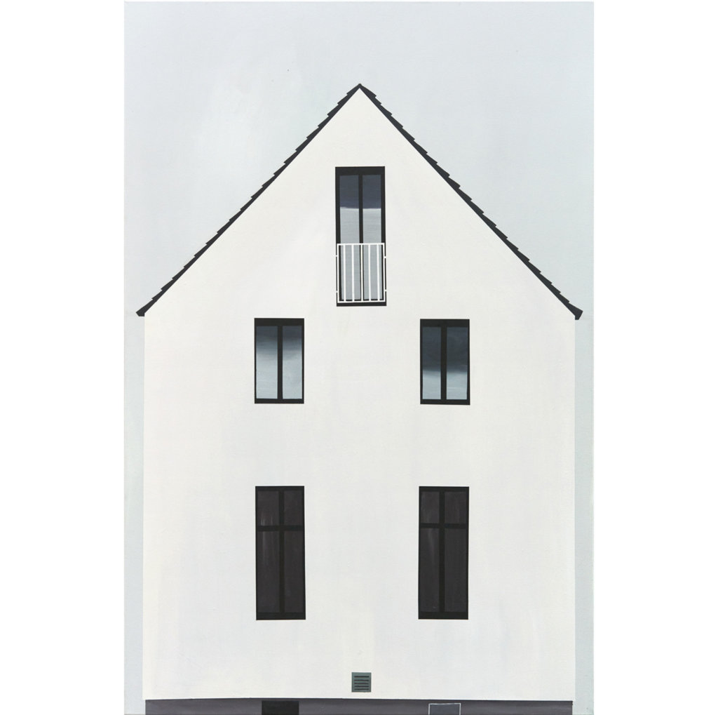 weißes Haus vor blauem Himmel