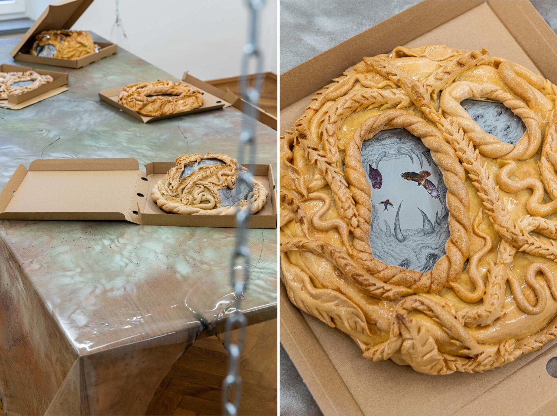 In offenen Pizza-Kartons liegen Gebäckkunstwerke von Anastasia Sosunova.
