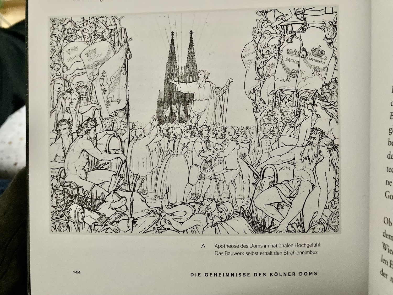 Ein Foto von einem aufgeschlagenen Buch, zu sehen ein Bild, dass einen Mann vorm Kölner Dom umringt von einer Menschenschar zeigt.